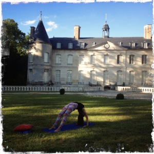 Elissa doing yoga in front of the Château de Verderonne, Image source: Quail Bell Magazine