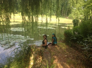Norma and me cooling off by the thousand year old moat at the Yoga & Writing Retreat the Château de Verderonne, France
